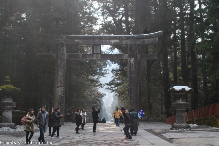 Leaving Nikko through an impressively tall, stone torii.