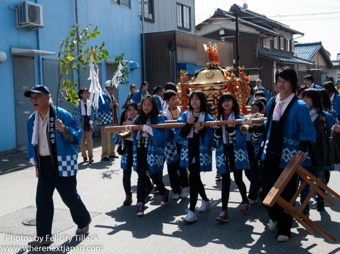 Some children carried one of two gleaming mikoshi.